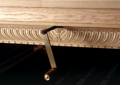 Detail showing Wind-up handle and framework carving oin Refectory snooker dining table